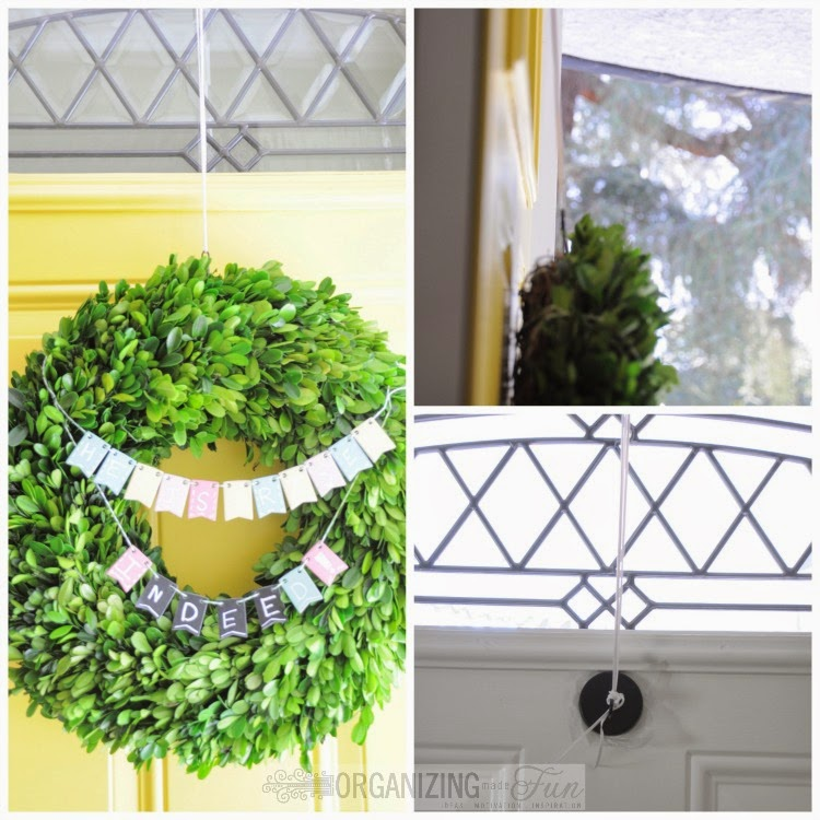Rigging up a way to hang the heavy boxwood wreath, using plastic lace over the door and a magnet on the back of the door :: OrganizingMadeFun.com