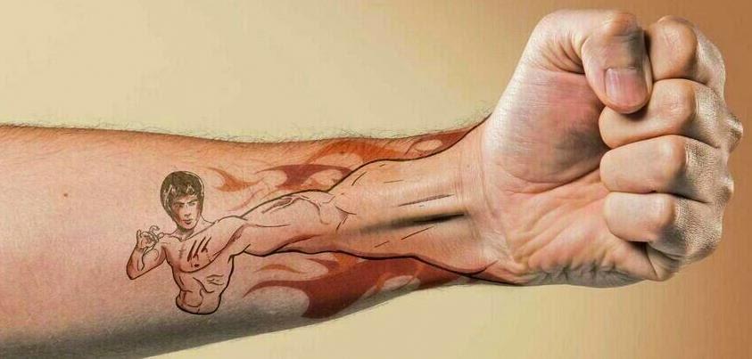 Tatuaje de Bruce Lee en el antebrazo
