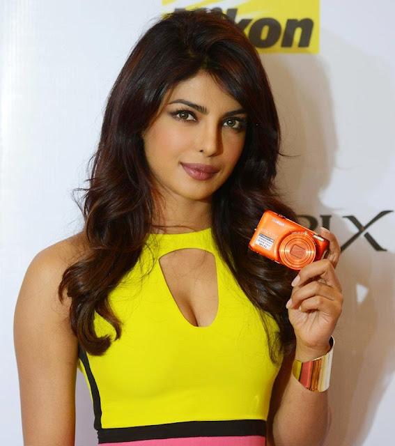 Priyanka Chopra in Bright Yellow Pink Dress at Camera Launch Event