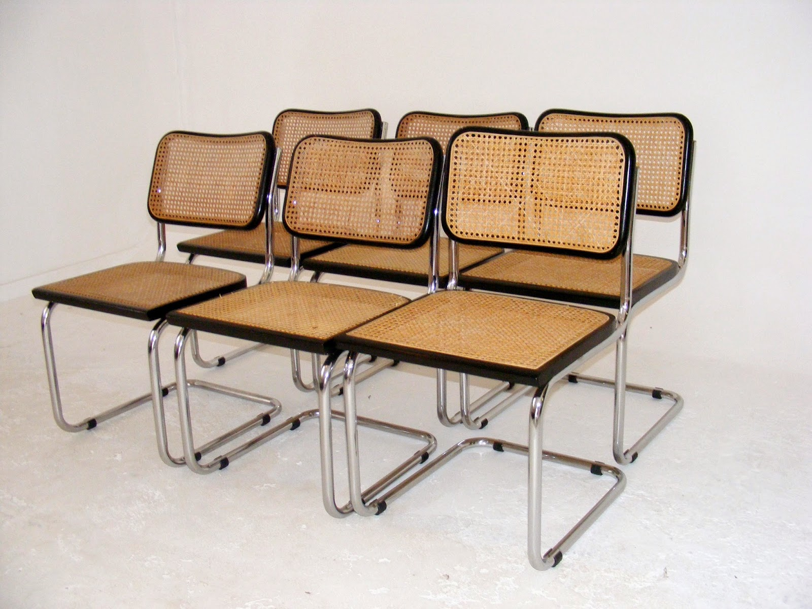 A set of 6 vintage replica 'Cesca' chairs made in Italy. The originals were  designed by Marcel Breuer in 1928.