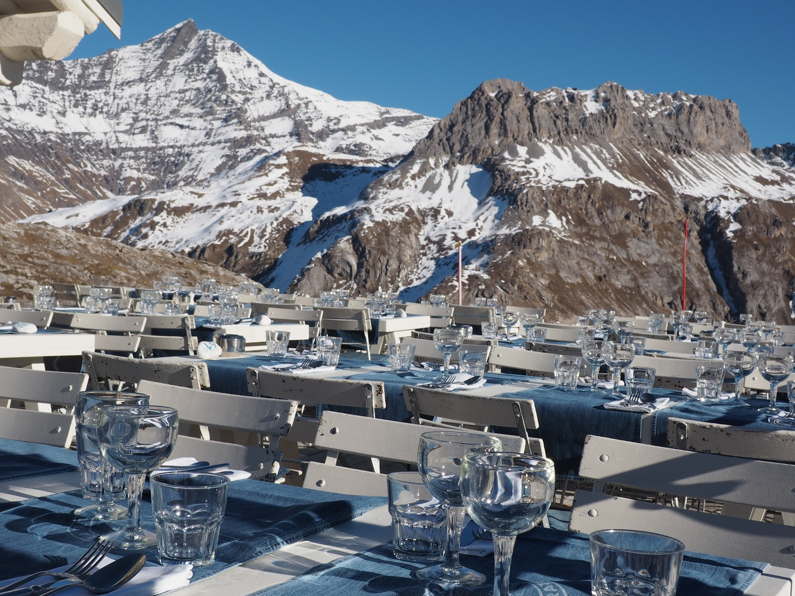 La Fruitiere tables against mountain, Val d'Isere, France