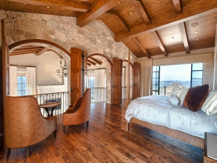 Bedroom in Mediterranean style vineyards home in Malibu