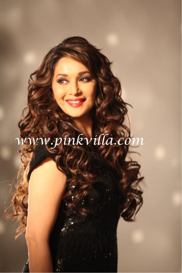 Madhuri posing in a black dress with luscious hair -  Madhuri Dixit Nene - new pics !!!