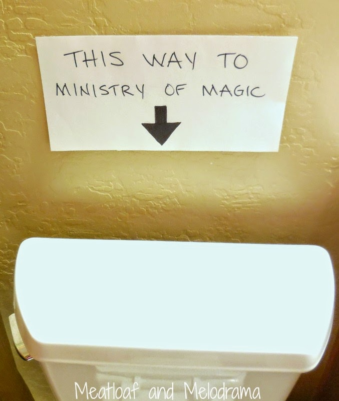 this way to ministry of magic sign over toilet