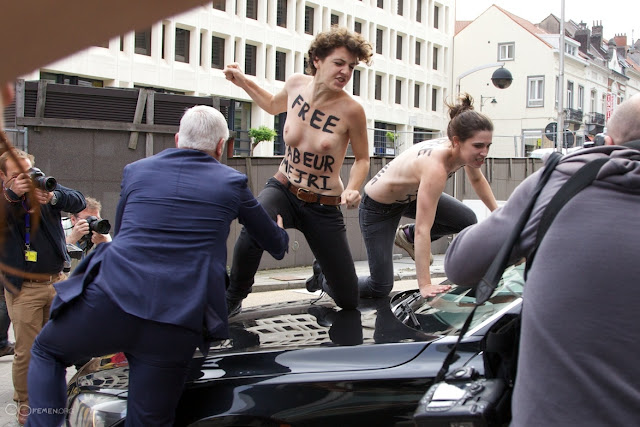 Topless FEMEN Protester Get Choked Out For Jumping On The Car Of Tunisian PM Ali Larayedh In Brussels