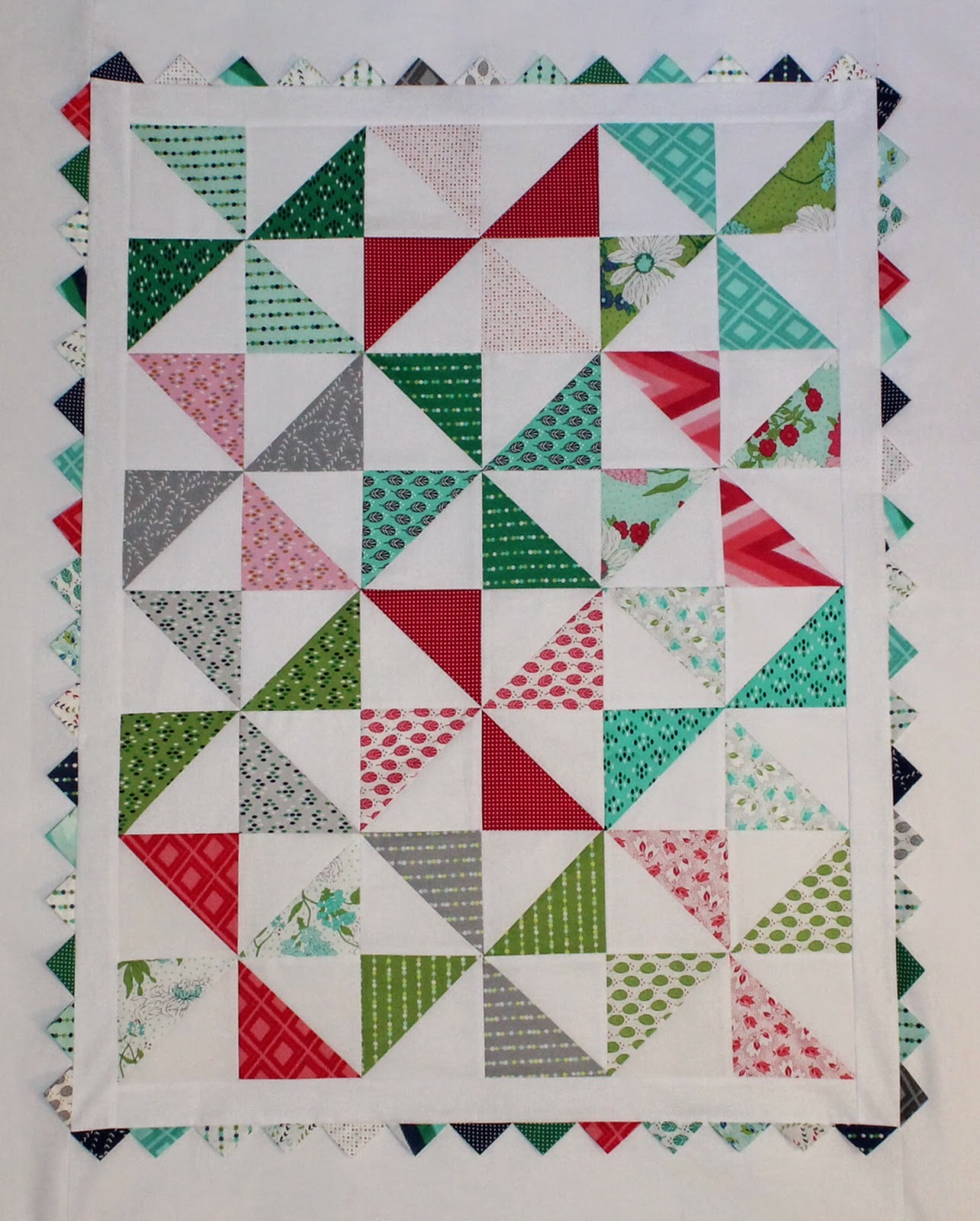 JulieQ Quilts: Using A Charm Pack to Make the Pinwheel Baby Quilt