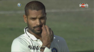 Shikhar-Dhawan-adujest-his-mustache-after-day3-stumps