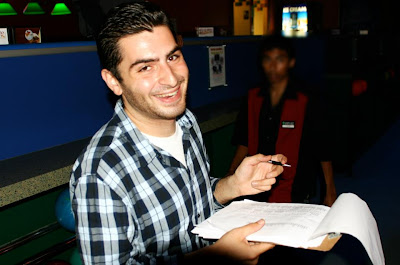 bowling night scorekeeper with his score pad
