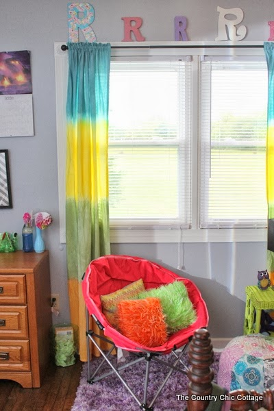A fun and colorful teen room reveal with tons of DIY ideas.  A great room on a budget with ideas for everyone!