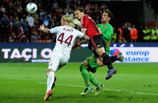AC Milan striker Zlatan Ibrahimović heads the ball to scores his second goal against AS Roma