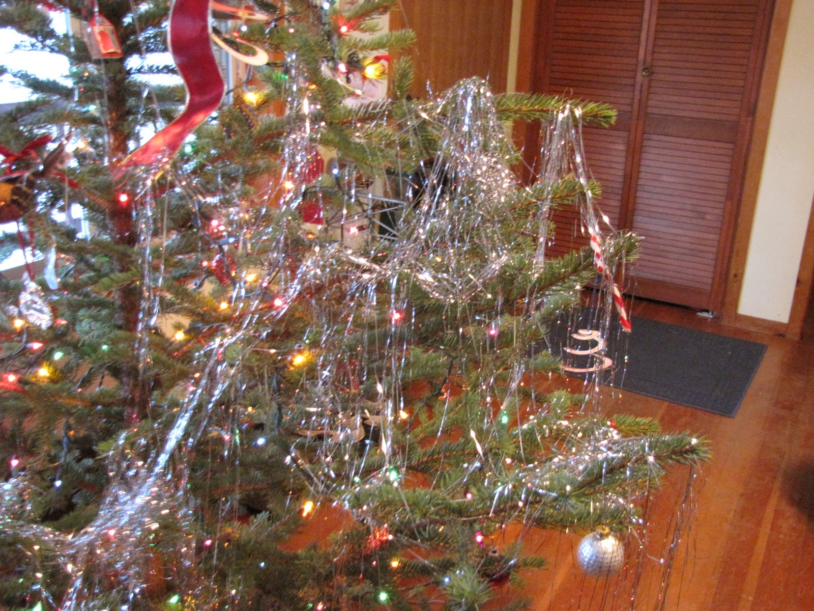and intriguing enough and the boys didnt exactly work on spacing out the garland so that it lightly covered the whole tree in shiny little icicle like - Icicles For Christmas Tree