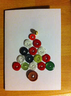 Homemade christmas card made with coloured recycled buttons sewn onto card