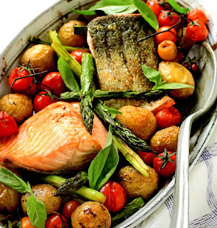 one pot dish of salmon, potatoes, tomatoes and asparagus. An excellent dish for Good Friday