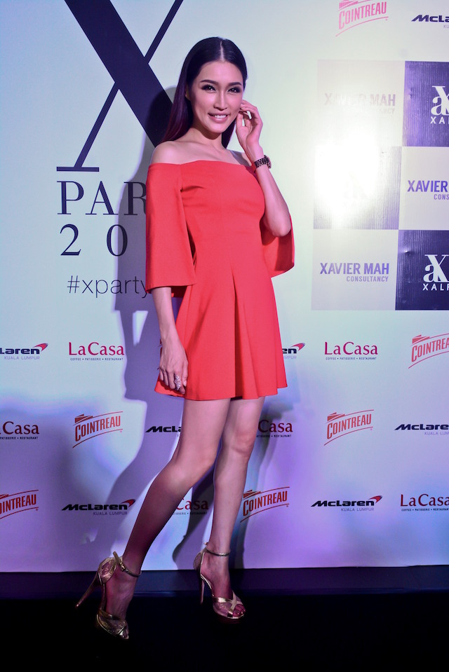 Amber Chia is looking radient as usual in a golden pair of XALF