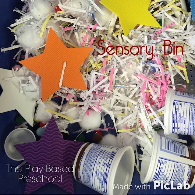 Textures, textures, textures - 5 senses sensory bin. Cotton balls and paper. All it needs now is some pasta.