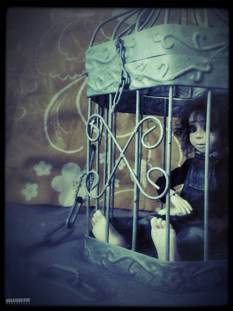Girl in the cage