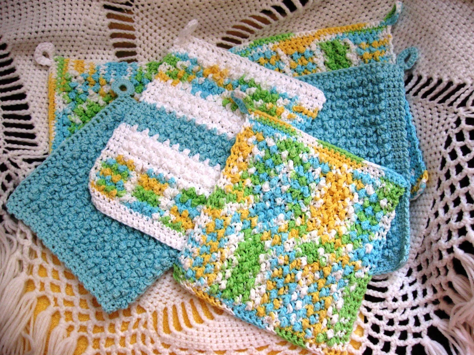 Cloths are crocheted in a seed stitch, to create a nubby texture for ...