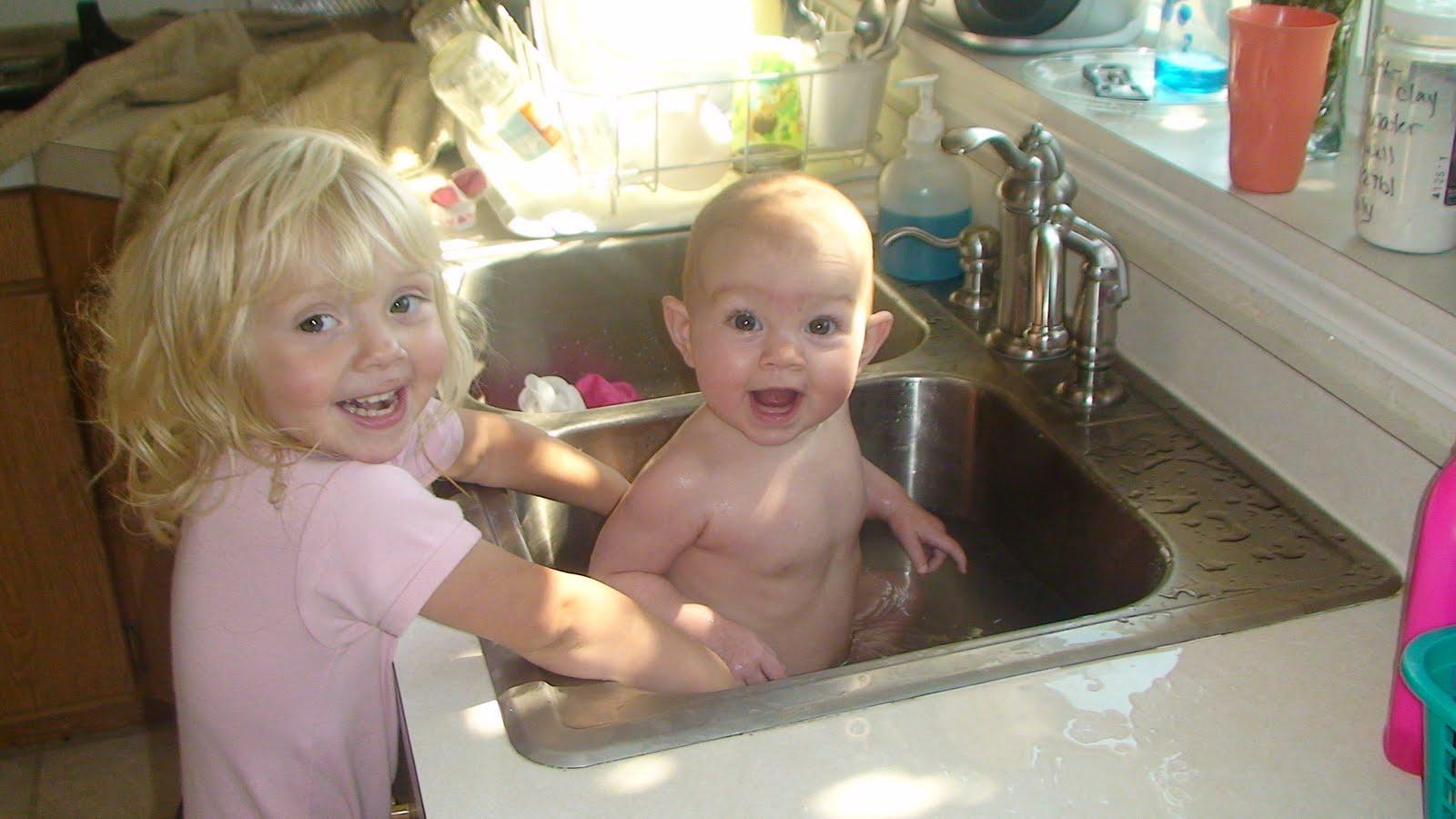 Twins Bathing In Kitchen Sink