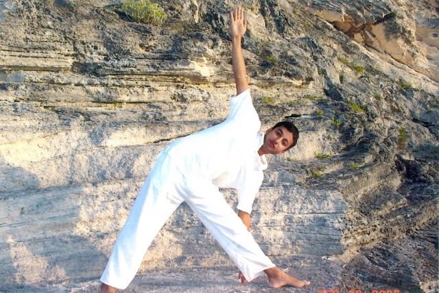 Yog master Rajendra Pandey practicing his daily yoga at beach Hamilton Bermuda