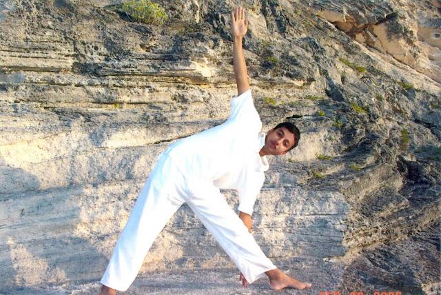 Yog master Rajendra Pandey practicing his daily yoga at beach Hamilton Bermuda