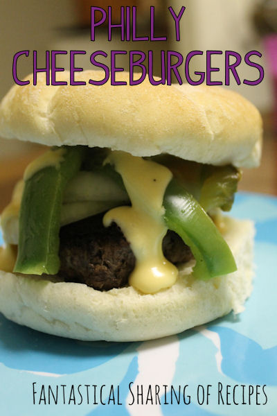 Philly Cheeseburgers - a juicy burger topped with peppers and onions and smothered in a beer cheese sauce | www.fantasticalsharing.com