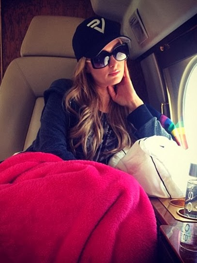 The Paris Hilton Poses in Private Plane in Square Sunglasses