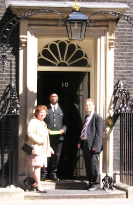 Yasmin Skelt and Simon Densley handing a copy of the Bioinitiative report into No 10 Downing Street for the Prime Minister, Gordon Brown
