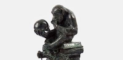 Chimp holding a skull