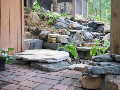 Rustic backyard waterfall with pavers backyard and patios for Ideas decorativas para patios