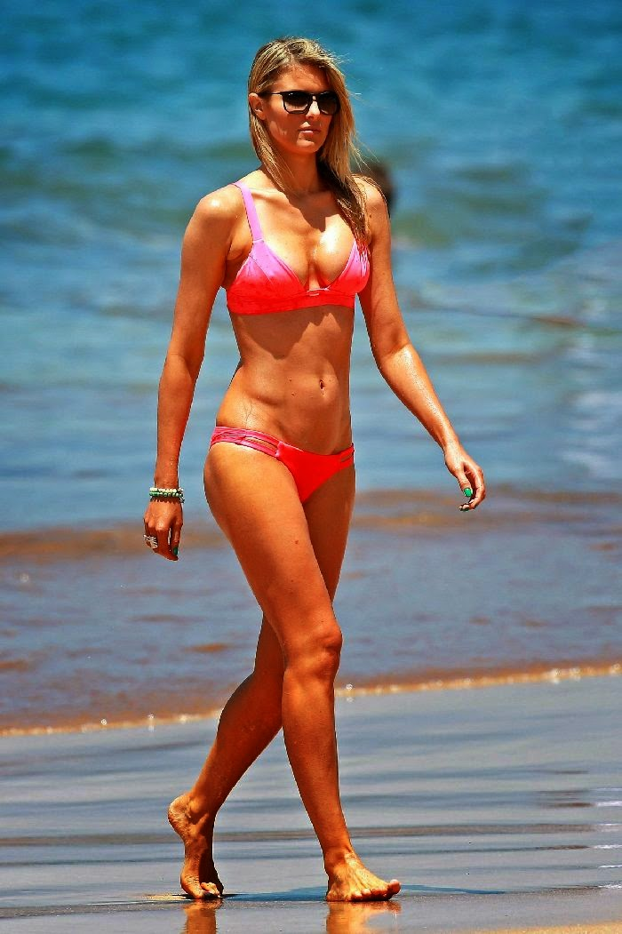 Paige Butcher displaying a red bikini as she enjoys the coolness in Miami