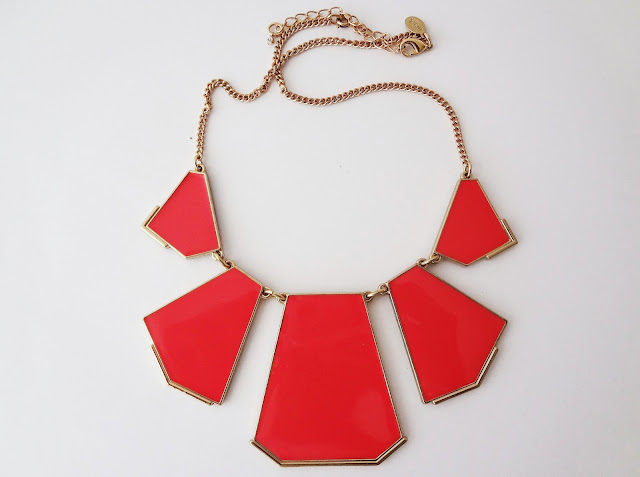mark. Great Shapes necklace with bright coral enameled panels.