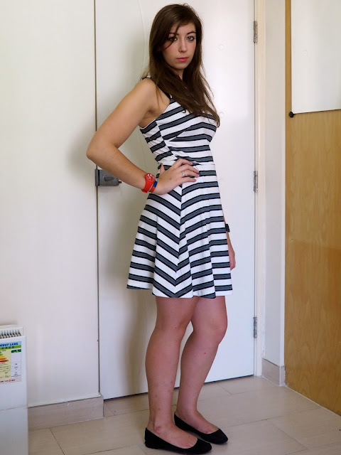 Simple Stripes | outfit of black & white striped skater dress with black flat shoes for work