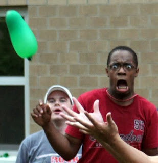 funny black man catching water balloon