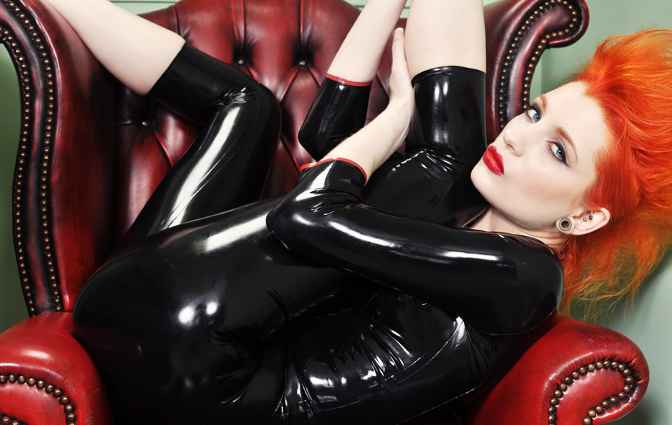 Fetish Inspirations : Black Latex Catsuit With Orange Hair