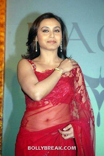 Rani is seen wearing a transparent red sari showing her navel -   Rani Mukerji is Doing 3 Item Dances in  new Film ayyaa!!!