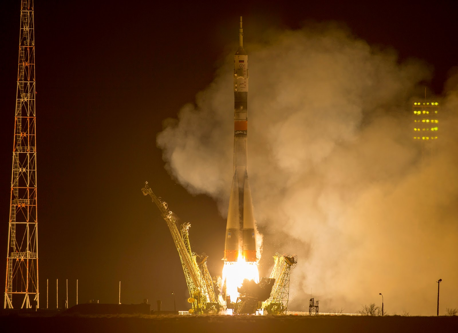 The Soyuz TMA-16M spacecraft is seen as it launches to the International Space Station with Expedition 43 NASA Astronaut Scott Kelly, Russian Cosmonauts Mikhail Kornienko, and Gennady Padalka of the Russian Federal Space Agency (Roscosmos) onboard Saturday, March 28, 2015, Kazakh time (March 27 Eastern time) from the Baikonur Cosmodrome in Kazakhstan. As the one-year crew, Kelly and Kornienko will return to Earth on Soyuz TMA-18M in March 2016. Photo Credit (NASA/Bill Ingalls)