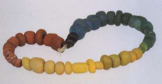 """Trade wind"" beads of brick red, yel-low, green, and black opaque glass, probably dating to the fifteenth centiny A.D."" These dis-tinctive beads were made in India by a drawn-glass technique. Many similar beads were exported, beginning in 200 B. C. and continuing up to the sev-enteenth century. They are labeled trade wind beads because they are found in archaeological sites by the Indian Ocean in East and South Africa and are believed to have arrived there in the ships of Arab, Indian, and Chinese traders, who sailed with the monsoon winds and ocean cur-rents. The beads are also found throughout Southeast Asia, including Thailand, Java, Malaysia, and Sumatra. Of particu-lar interest are the brick red beads, known as ""Indian reds"" in Africa and as rnutisalah in Timor."