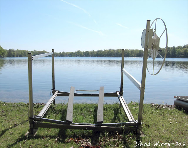 Aluminum Boat Lifts : Cottage on the lake putting in dock and boats