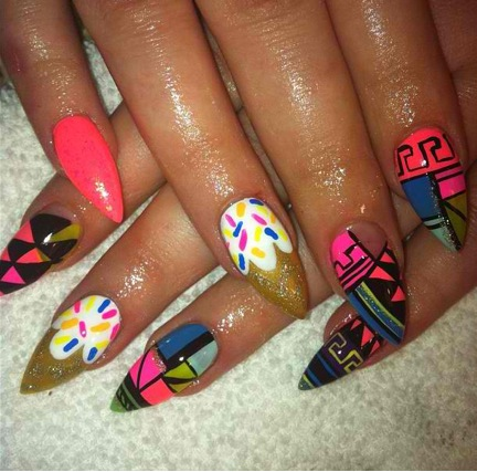Pointed nails with aztec designs!