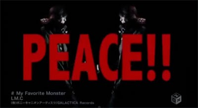 """PEACE"" in large red letters while mirror images of Aiji play guitar."