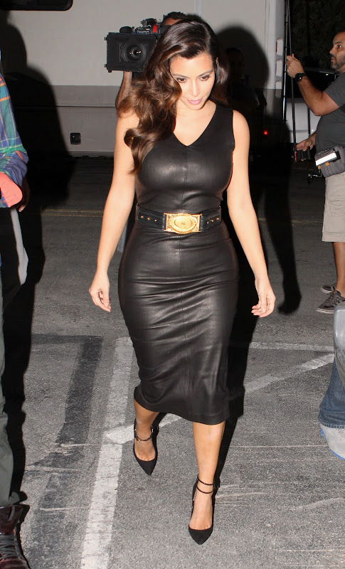 Kim Kardashian wearing a body tight leather dress
