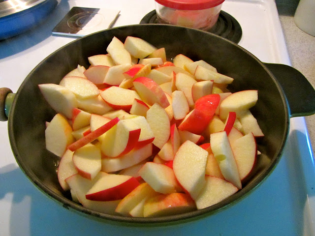 cut apples with skins on in a large cast iron skillet on the stove