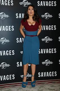 Salma Hayek in tight dress and blue high heels