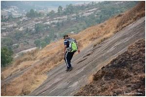 Descending the steep rock