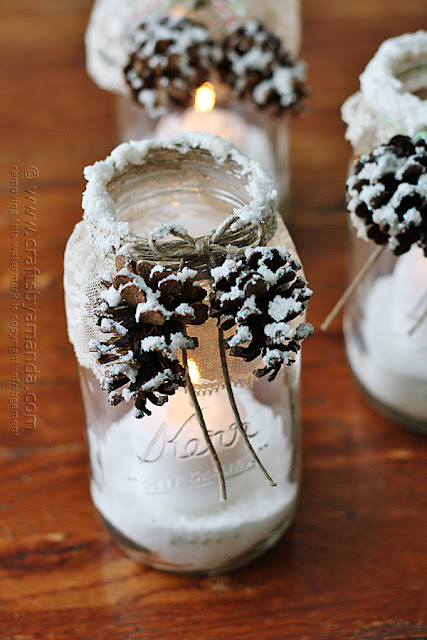 http://craftsbyamanda.com/2013/12/snowy-pinecone-candle-jars.html