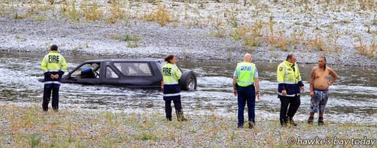 Police and fire service attended an accident where a man's vehicle was stuck in the Ngaruroro River near the Hawke's Bay Expressway bridge, north of Hastings. Police then gave him a ticket for his driving activity earlier in the day. photograph