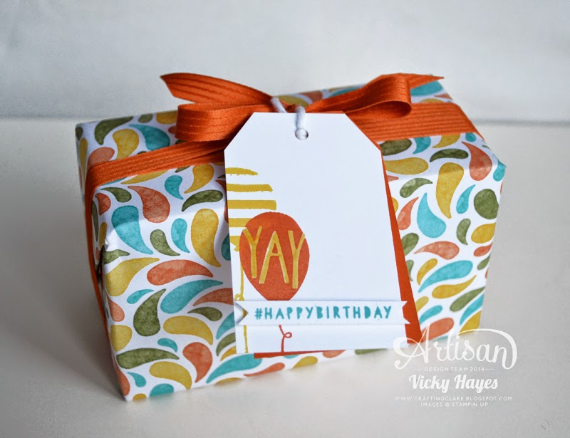 Use designer paper as gift wrap and make a matching tag