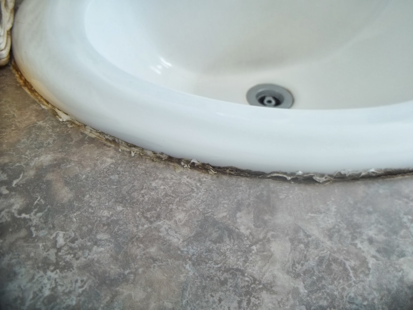 Bathroom Sink Caulk. Now With The Old Caulk Removed And The Battle ...