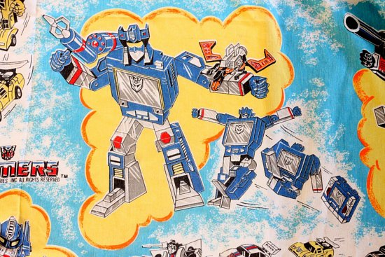 A Transformers Generation One Flat sheet from 1984! It's a thing of beauty  in my room and perfectly goes with the robot art above the bed.