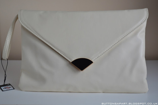 a picture of a cream clutch from primark